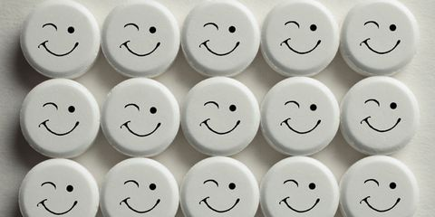 White, Facial expression, Number, Emoticon, Circle, Symbol, Plastic, Button, Smiley,