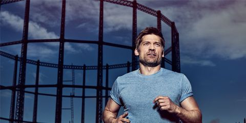 Beard, Muscle, Facial hair, Flash photography, Iron, Chest, Portrait photography, Fence, Wire fencing, Active shirt,