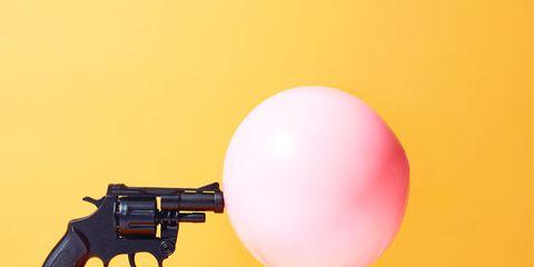 Gun, Firearm, Trigger, Gun accessory, Tan, Revolver, Peach, Gun barrel, Air gun, Still life photography,