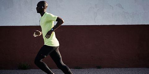 Leg, Human leg, Standing, Athletic shoe, Sportswear, Knee, Running, Asphalt, Jersey, Track and field athletics,