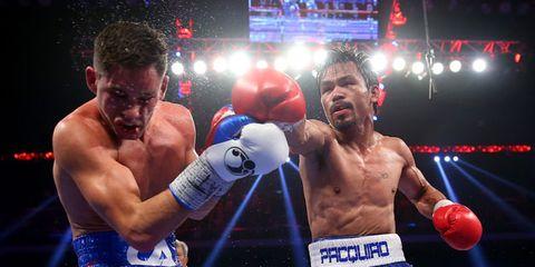 Nose, Sport venue, Boxing, Boxing glove, Sports uniform, Boxing equipment, Sports equipment, Professional boxer, Combat sport, Contact sport,