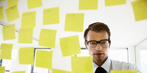 Eyewear, Glasses, Vision care, Yellow, Dress shirt, Collar, Facial hair, Paper product, White-collar worker, Job,