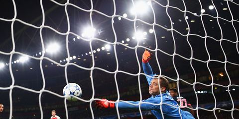 Sports equipment, Goalkeeper, Soccer ball, Team sport, Net, Soccer, Ball, Sport venue, Soccer player, Football,