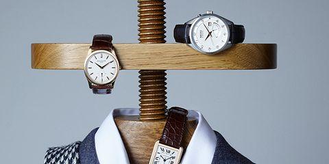 Dress shirt, Collar, Textile, Still life photography, Analog watch, Button, Design, Pocket, Circle, Clock,