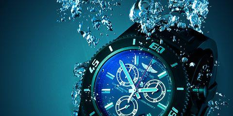 Watch, Analog watch, Glass, Liquid, Font, Clock, Aqua, Watch accessory, Space, Still life photography,