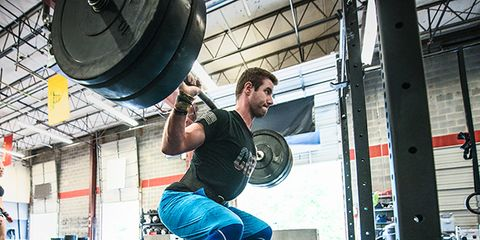 Weightlifter, Human leg, Chin, Physical fitness, Exercise equipment, Shoulder, Shoe, Joint, Standing, Barbell,