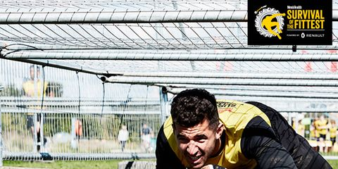 Wire fencing, Photo caption, Mesh, Football player, Chain-link fencing, Fictional character, Kneeling,