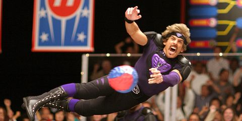 Arm, Elbow, Sports uniform, Joint, Glove, Purple, Sports gear, Competition event, Thigh, Contact sport,
