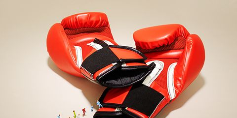 Red, Personal protective equipment, Orange, Boxing glove, Boxing equipment, Glove, Sports gear, Lacrosse glove, Fashion accessory,