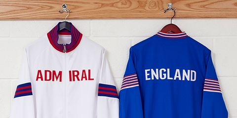 Sports uniform, Blue, Jersey, Product, Sportswear, Collar, Sleeve, Text, Textile, Red,
