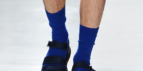 Blue, Sock, Human leg, Electric blue, Cobalt blue, Costume accessory, Knee, Majorelle blue, Ice skate, Ankle,