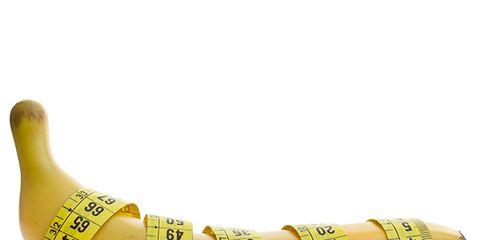 Yellow, Banana, Banana family, Fashion accessory, Tape measure, Hand, Finger, Plant,