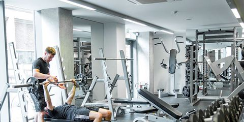 Gym, Physical fitness, Exercise equipment, Room, Weight training, Sport venue, Arm, Exercise machine, Weightlifting machine, Bodybuilding,