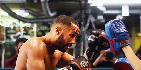 Professional boxer, Boxing glove, Boxing, Combat sport, Sport venue, Professional boxing, Striking combat sports, Contact sport, Boxing ring, Barechested,