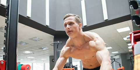 Barechested, Muscle, Shoulder, Exercise equipment, Physical fitness, Arm, Chest, Standing, Chin, Fitness professional,