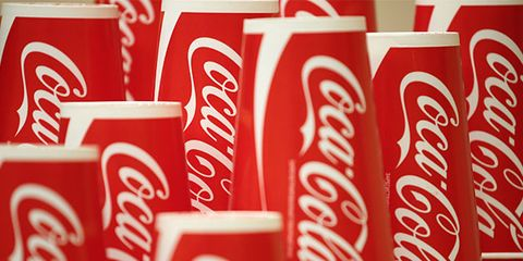 Coca-cola, Drink, Carbonated soft drinks, Cola, Coca, Soft drink, Beverage can, Plant, Non-alcoholic beverage, Font,