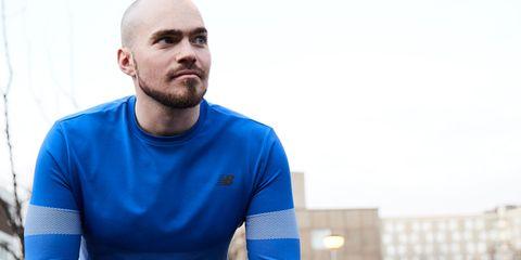 Blue, Arm, Sitting, Muscle, T-shirt, Elbow, Facial hair, Photography, Neck, Beard,