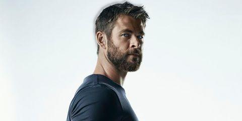 Facial hair, T-shirt, Beard, Shoulder, Chin, Arm, Neck, Standing, Muscle, Elbow,