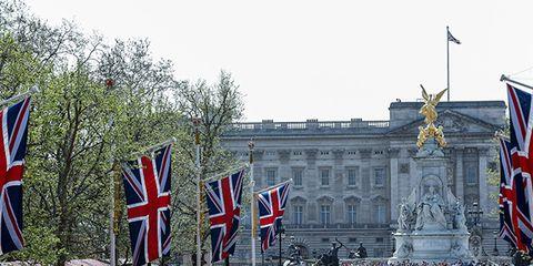 Flag, Flag of the united states, Landmark, Crowd, Architecture, Metropolitan area, City, Event, Town square, Tourism,