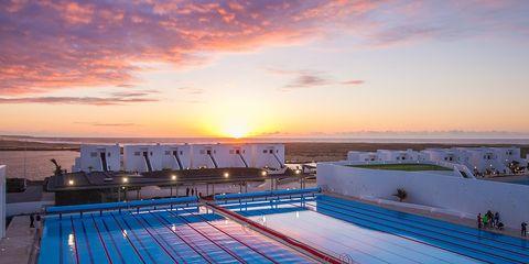 Swimming pool, Sky, Leisure centre, Daytime, Line, Sunlight, Leisure, Sport venue, World,