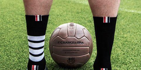 Soccer ball, Football, Ball, Sports equipment, Grass, Ball game, Player, Joint, Team sport, Sports,