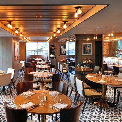 Lighting, Room, Interior design, Glass, Furniture, Table, Ceiling, Amber, Light fixture, Restaurant,
