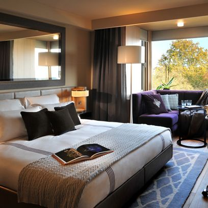 Interior design, Room, Lighting, Bed, Floor, Bedding, Property, Textile, Furniture, Wall,