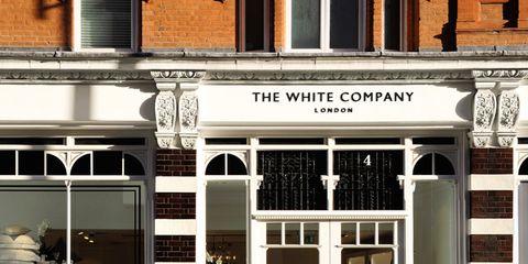 Facade, Door, Fixture, Commercial building, Signage, Display window, Molding, Column,