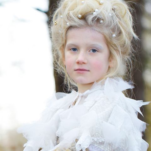 Mouth, Hairstyle, Iris, Blond, Portrait photography, Fur, Child model, Portrait, Costume, Embellishment,