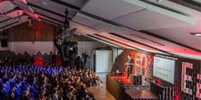 People, Crowd, Ceiling, Audience, Community, Hall, Convention, Stage, Auditorium, Public speaking,