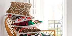 Room, Textile, Furniture, Interior design, Linens, Cushion, Pattern, Pillow, Home accessories, Wicker,