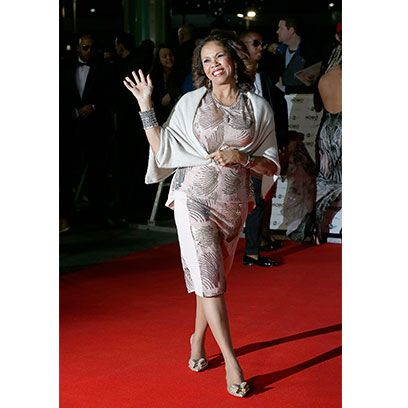 Style, Flooring, Formal wear, Fashion, Carpet, Sandal, Fashion design, Fashion model, High heels, Handbag,