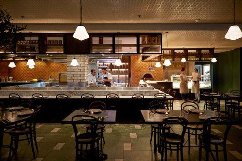 Restaurant, Building, Café, Cafeteria, Table, Food court, Coffeehouse, Room, Interior design, Bar,