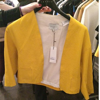 Product, Yellow, Sleeve, Textile, Collar, Clothes hanger, Fashion, Sweater, Fashion design, Brand,