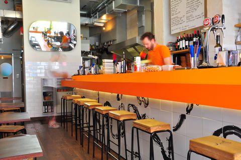 Barware, Bottle, Drink, Customer, Restaurant, Bar, Distilled beverage, Stool, Drinking establishment, Countertop,
