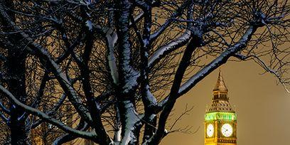Tree, Winter, Landmark, Snow, Metropolitan area, City, Urban area, Yellow, Town, Architecture,