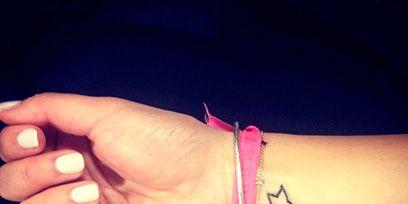 Finger, Skin, Wrist, Joint, Nail, Close-up, Thumb, Symbol, Bracelet, Body jewelry,