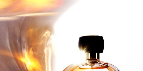 Perfume, Amber, Orange, Bottle, Circle, Still life photography, Graphics, Brass, Bottle cap, Ornament,