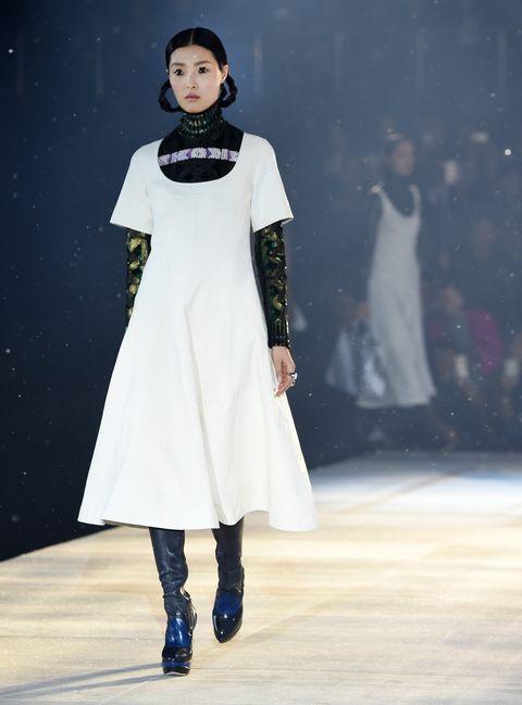 Sleeve, Human body, Dress, Joint, Fashion model, Fashion, Costume design, Street fashion, Fashion show, One-piece garment,
