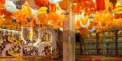 Lighting, Orange, Interior design, Furniture, Amber, Lantern, Light fixture, Decoration, Hall, Chandelier,