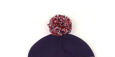 Red, Headgear, Costume accessory, Maroon, Bonnet, Coquelicot, Headpiece, Pom-pom, Label, Creative arts,