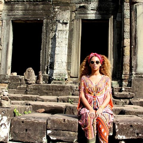 Street fashion, Temple, Magenta, Maroon, Sunglasses, Ancient history, Ruins, Long hair, History, Column,