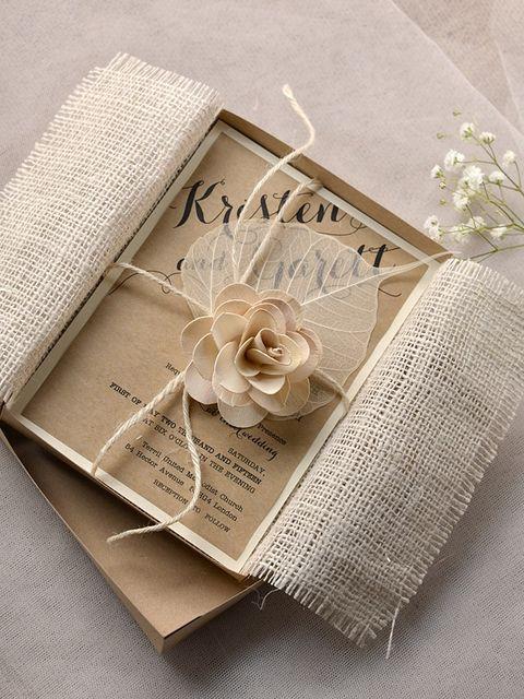 Petal, Paper product, Beige, Paper, Material property, Ribbon, Embellishment, Floral design, Craft, Publication,
