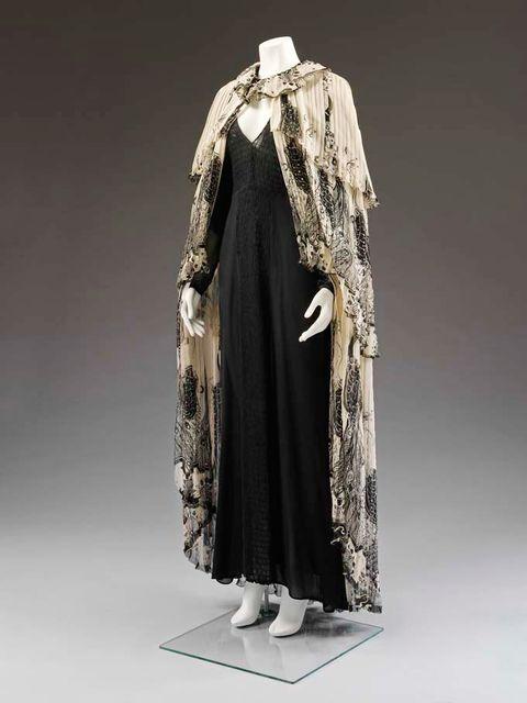 Clothing, Sleeve, Textile, Costume design, Fashion, Beige, Costume, Clothes hanger, Fashion design, Pattern,