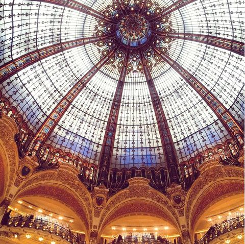 Glass, Architecture, Amber, Fixture, Tints and shades, Symmetry, Hall, Arcade, Daylighting, Classical architecture,