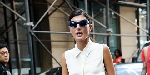 Clothing, Eyewear, Vision care, Shoulder, Joint, White, Jeans, Street, Sunglasses, Fashion accessory,