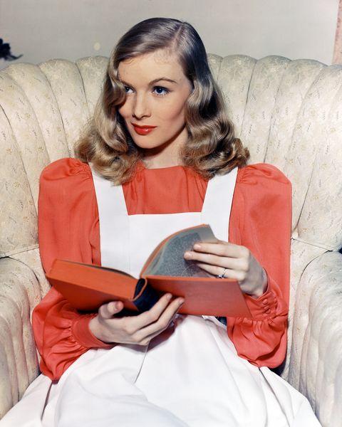 Comfort, Sitting, Couch, Living room, Eyelash, Reading, Lap, Long hair, Pillow, Layered hair,