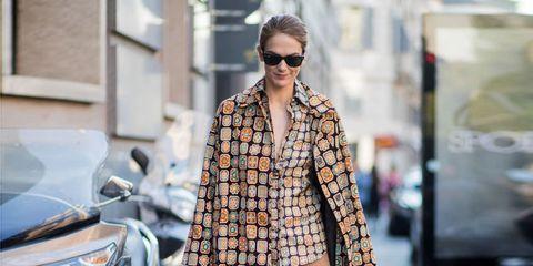 Clothing, Street fashion, Fashion, Eyewear, Fashion model, Outerwear, Sunglasses, Coat, Footwear, Shoe,