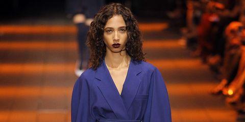 Blue, Sleeve, Human leg, Shoulder, Joint, Outerwear, Fashion show, Style, Orange, Fashion model,