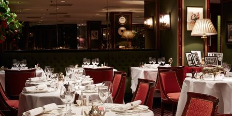 Tablecloth, Lighting, Furniture, Textile, Function hall, Dishware, Linens, Interior design, Table, Restaurant,